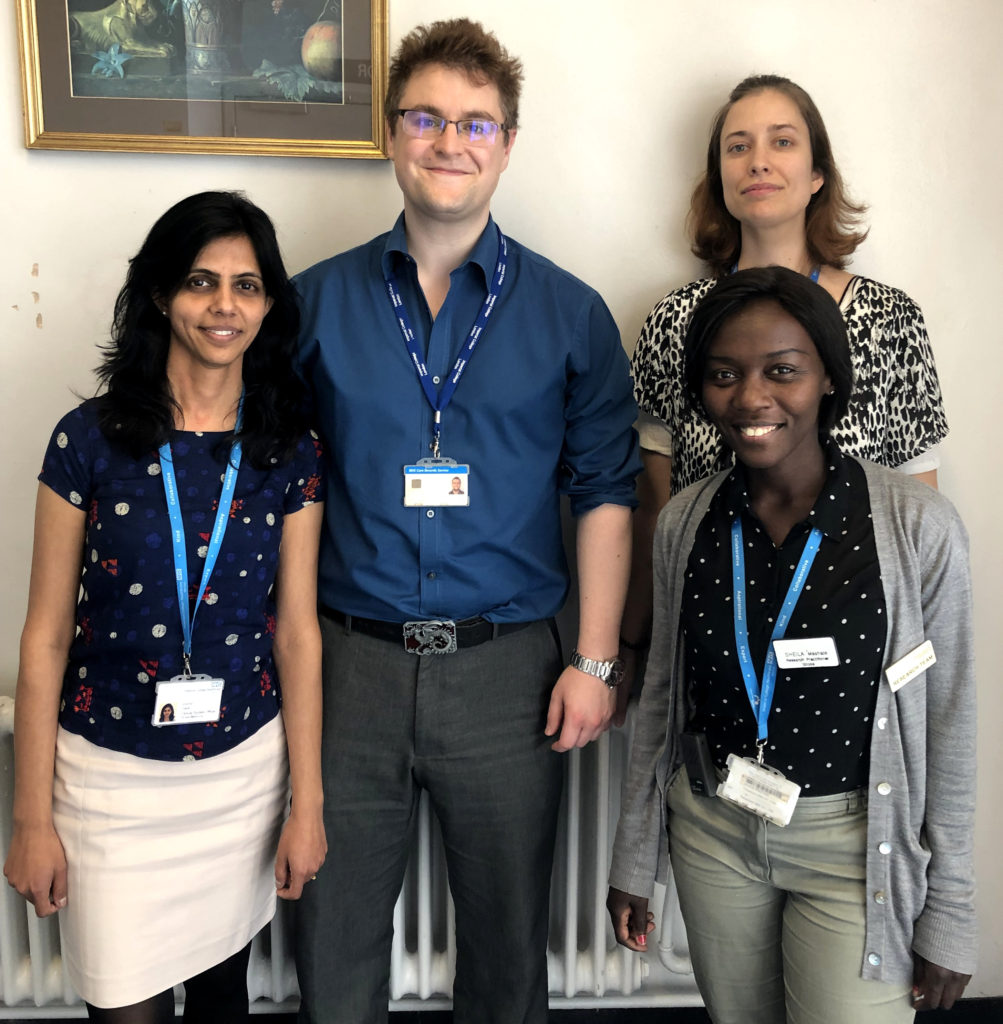 Imperial College Healthcare NHS Trust team of four people standing looking at the camera