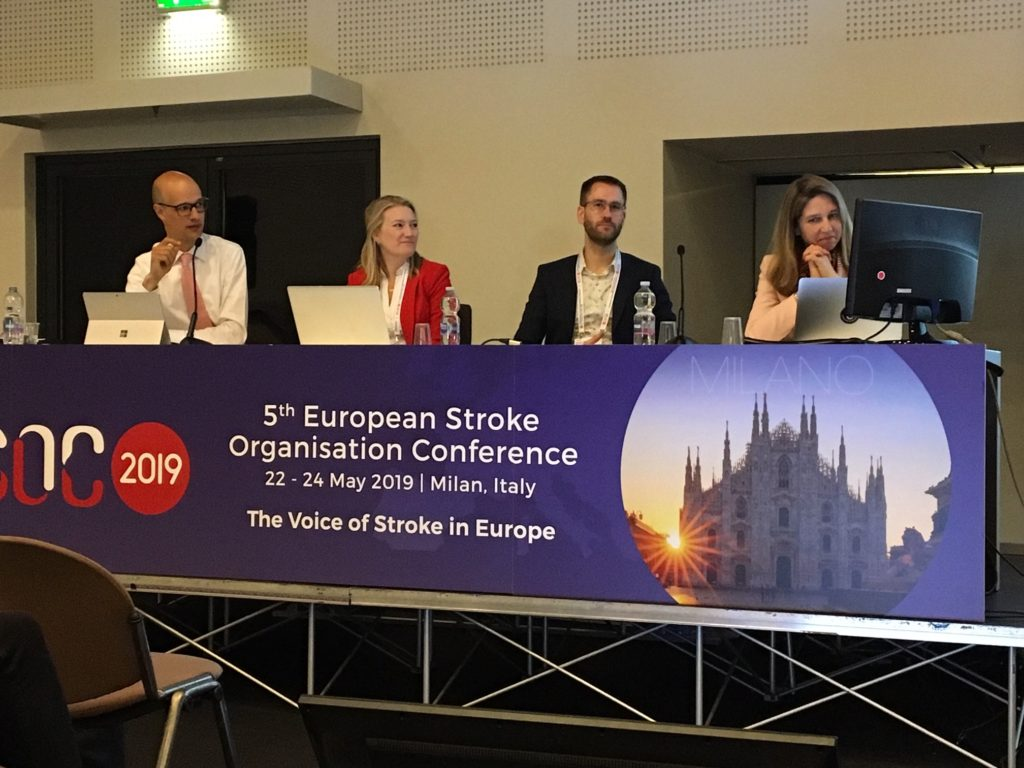 Prof Stephanie Debette (Universite de Bordeaux, PRESTIGE-AF consortium member and leader of the genetics component) sitting on a panel with Rustam Al-Shahi Salman (University of Edinburgh, Edinburgh, Scotland) and two other people
