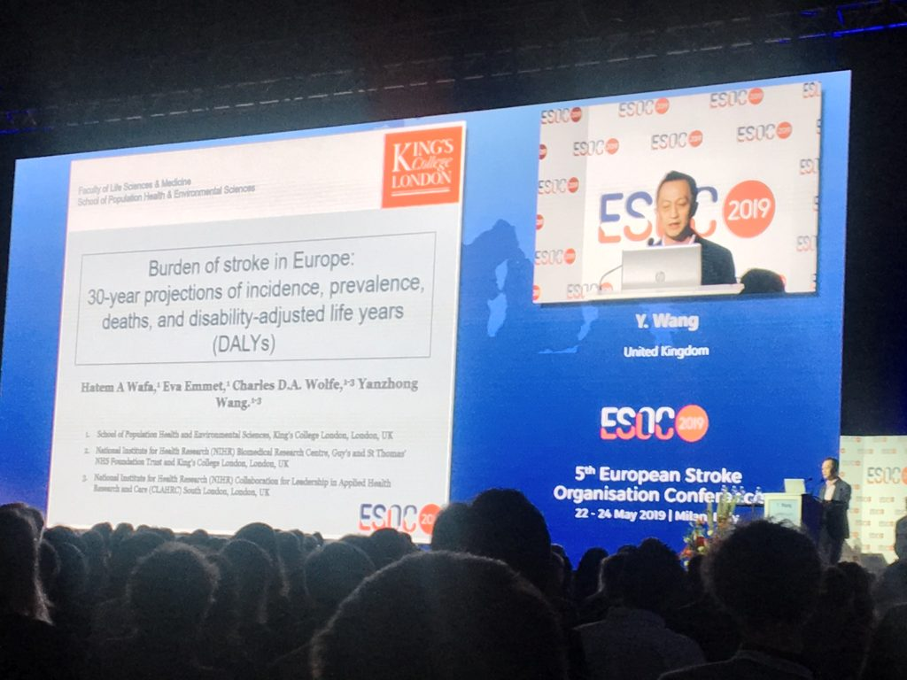 Dr Yanzhong Wang on a big screen with a slide title 'Burden of Stroke in Europe: 30-year projections of incidence, prevalence, deaths, and disability-adjusted life years (DALYs)'