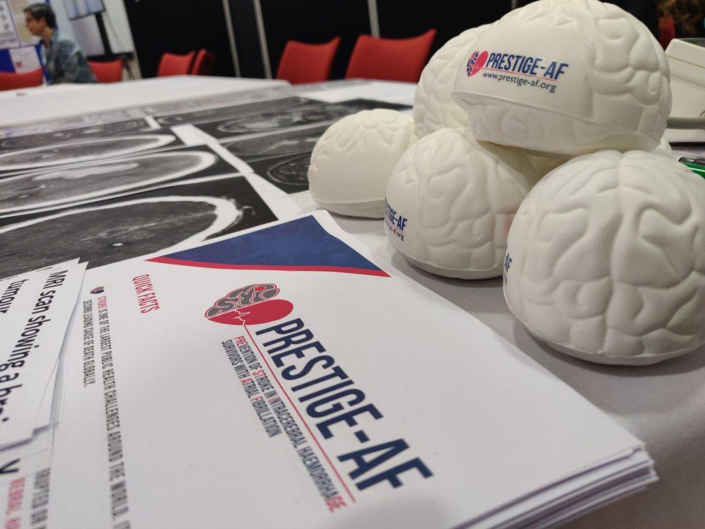 PRESTIGE-AF stress brains and information sheets on a table